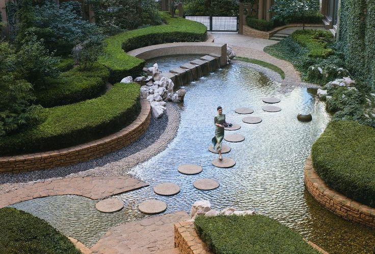 Shangri-la inner circle landscape - I know this is in an oriental garden but the thought of being used as a children's splash pad would be neat. It could be drained easy for the winter months.