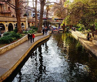 Cypress-lined cobble-and-flagstone paths meander for four miles along both sides of the narrow San Antonio River. Locals and visitors come to the River Walk's horseshoe-shaped loop downtown to browse shops and hang out at restaurants like Boudro's for a prickly-pear margarita and guacamole prepared tableside.