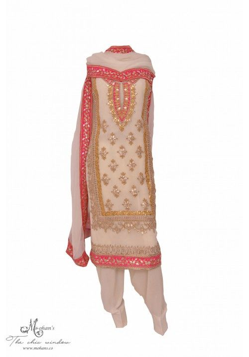 Traditional ivory suit accentuated with gota work