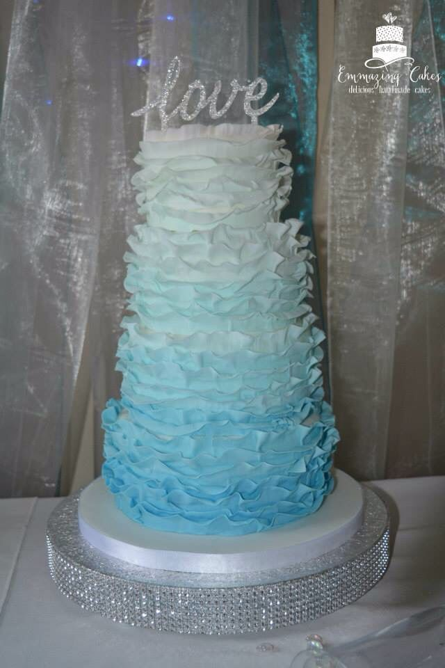 Blue ombre ruffle wedding cake. More at www.facebook.com/emmazingcakes