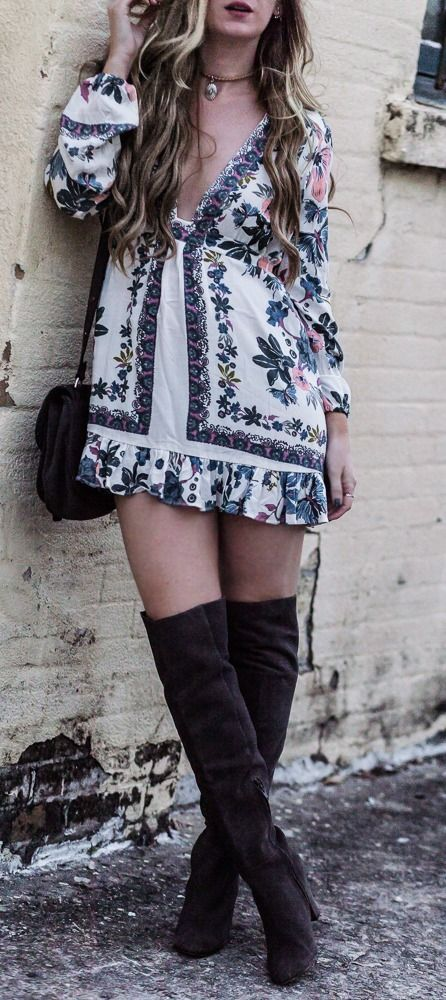 Spring boho outfit styled with floral Free People dress and gray over the knee boots