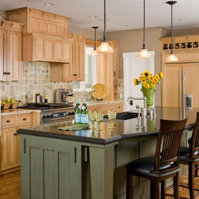 Kitchen & bath fixtures , appliances , tile, stone & countertops , cabinets & cabinetry , woodworkers. Island Cabinetry shown with Lancaster door style in Maple with Tea Green/Espresso Glaze/Rub