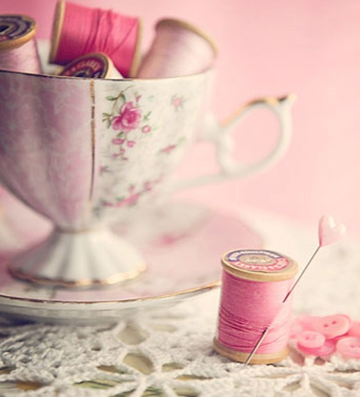 Pink vintage thread gathered in a tea cup