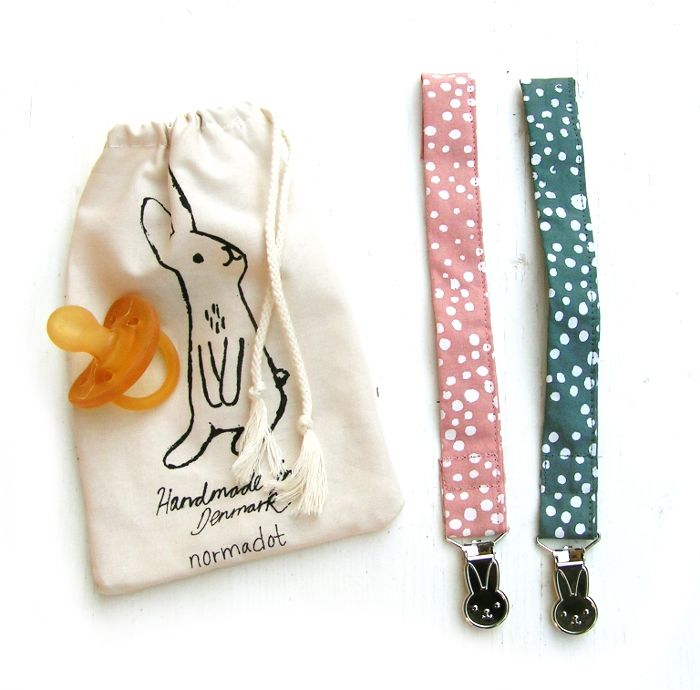 Keep pacifiers close at hand with our new Pacifier holder Hand screen printed polkadots & rabbit metal clip  www.normadot.com www.normadot.etsy.com