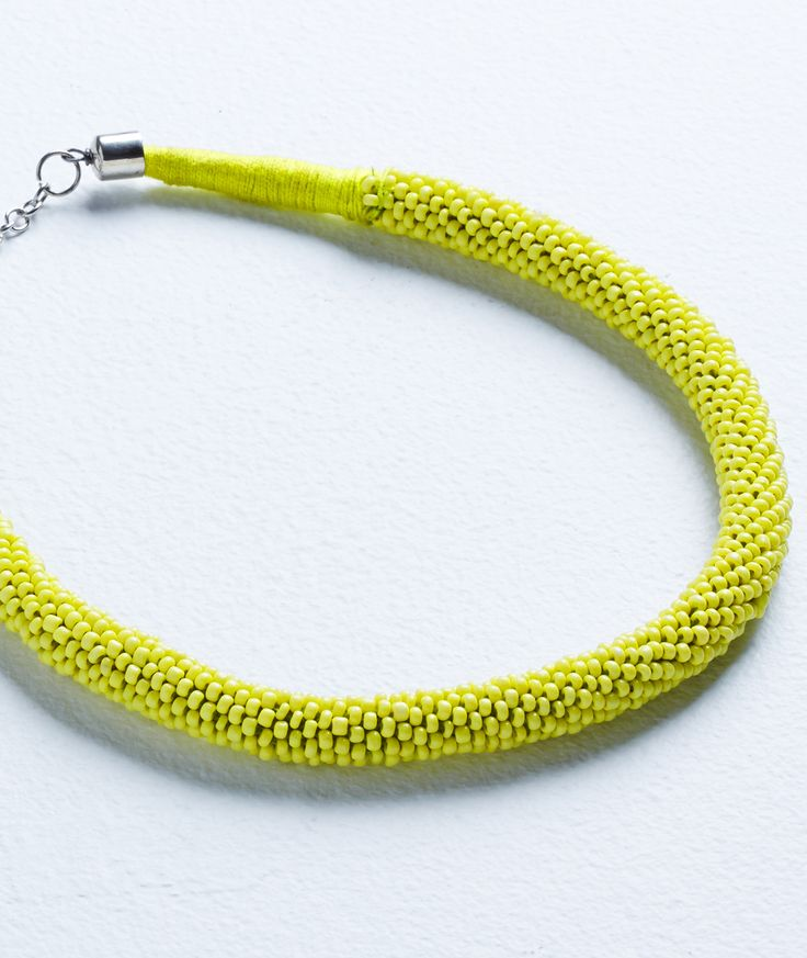 Inject a pop of colour to your neckline with this short beaded collar in lush lime.