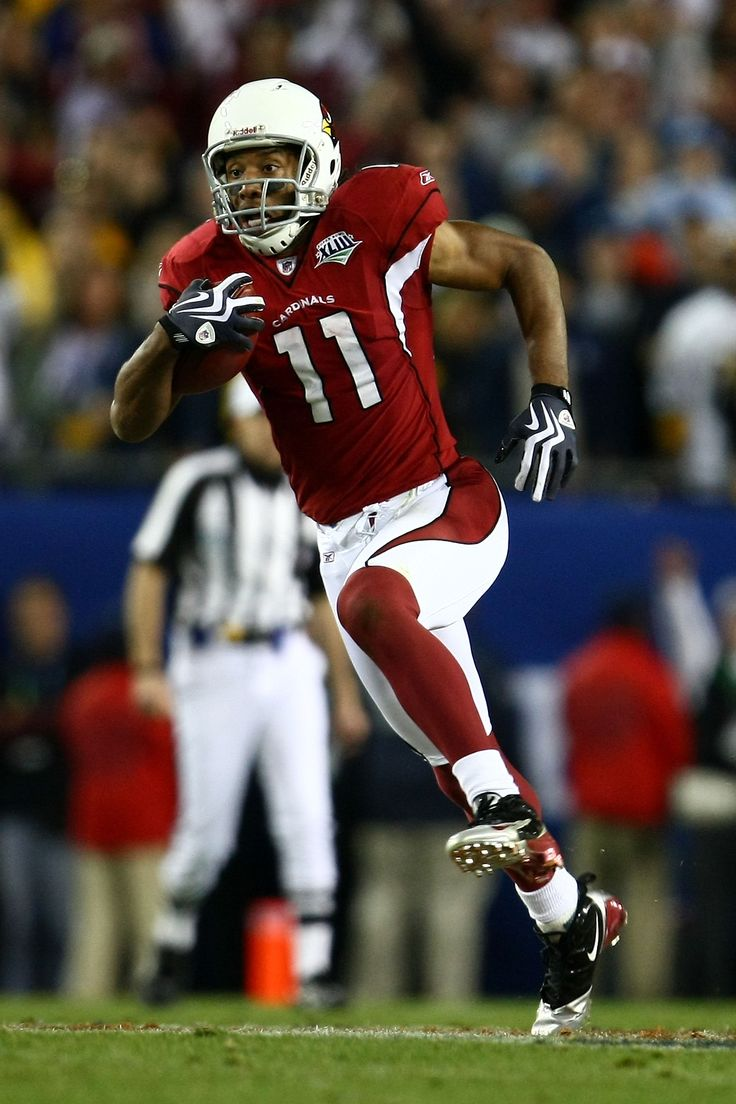 Wide receiver Larry Fitzgerald of the Arizona Cardinals scores a 64-yard touchdown reception in the fourth quarter against the Pittsburgh Steelers during Super Bowl XLIII.