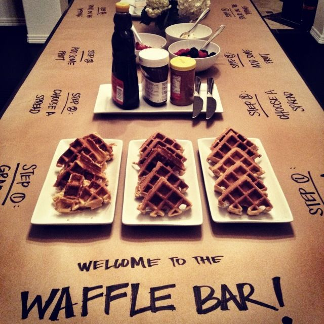 "Waffle Bar... instructions for guests written on the butcher paper ""tablecloth"""