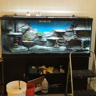 I made this background for my 120 gallon aquarium. It was actually pretty easy to make but it was very time consuming and messy. I'd definitely do it again though!...