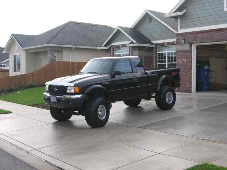 2002 Ford Ranger Lifted. Not sure I like the tires, but It's still beautiful!!!