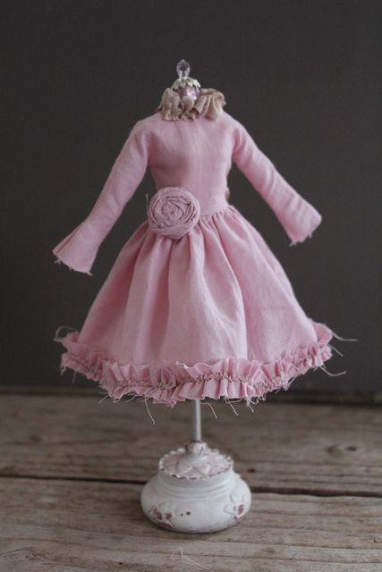 Abi Monroe makes some beautiful dolls. But I'm always DRAWN to the clothes...and she makes fabulous ones!