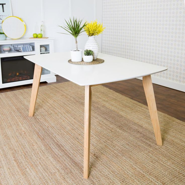 Bring retro flair into your kitchen or dining area with this stunning Retro Modern Dining Table. The beautifully painted white finish is accentuated by natural solid wood legs, making this dining set the perfect addition in your home. The neutral color palette makes this table an easy fit with your home decor while the unique design adds a vintage vibe.