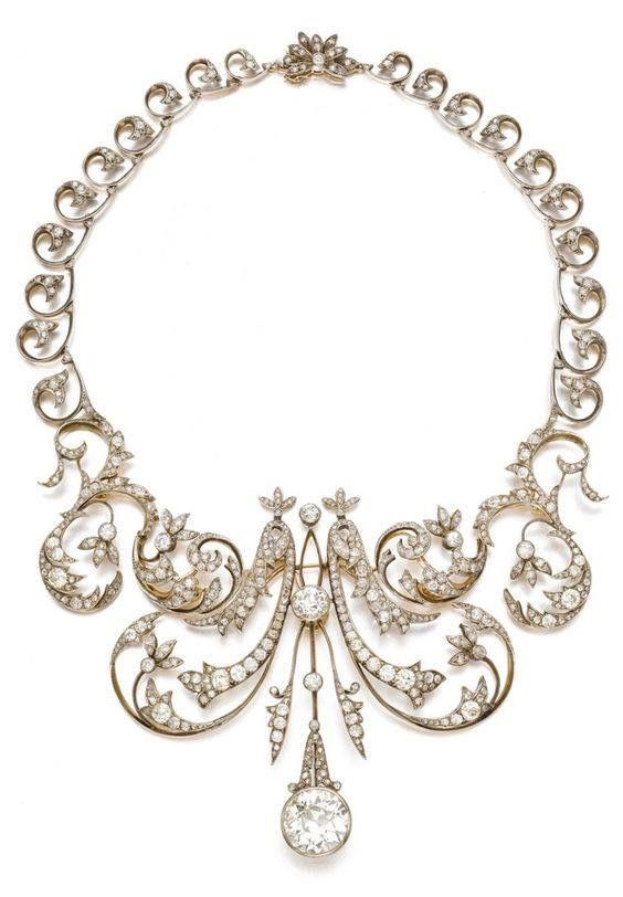 Stunning diamond necklace in a gold scroll and foliate setting with detachable central motif, circa 1900. Sotheby's...