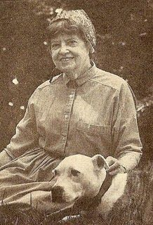 American illustrator Eloise Wilkin..She is remembered for illustrating the classic Little Golden Books. She used her own family as models for her characters..her art popped off pages in ways in which words were almost unnecessary. She passed away on October 4, 1987. Pictured with her pet pit bull.