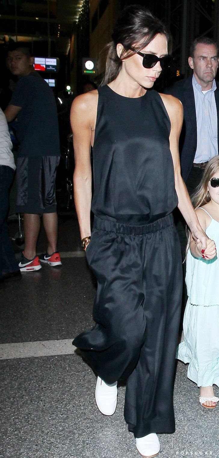 Pin for Later: Victoria Beckham's 1 Rule For Travel Style Is About to Change Your Life Victoria Wearing a Black Silk Jumpsuit, April 2016