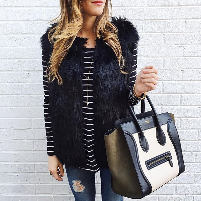 Black fur vest + stripe top.