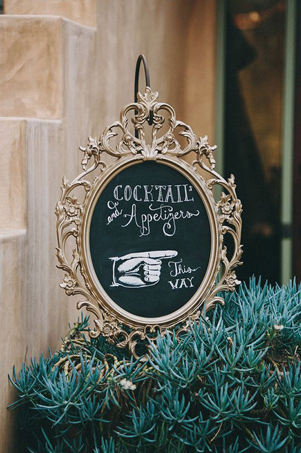 Here's another way to use an Ung Drill: Turn it into a chalkboard to direct guests to the food (and booze).