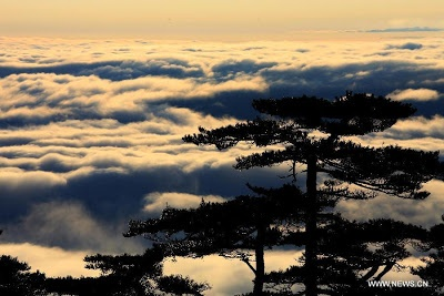 Photo taken on Dec. 2, 2012 shows the sea of clouds after a rainfall at Huangshan Mountain scenic spot in Huangshan City, Anhui Province. (Xinhua/Shi Guangde)  http://www.chinatraveltourismnews.com/2012/12/magnificent-view-at-huangshan-mountain.html