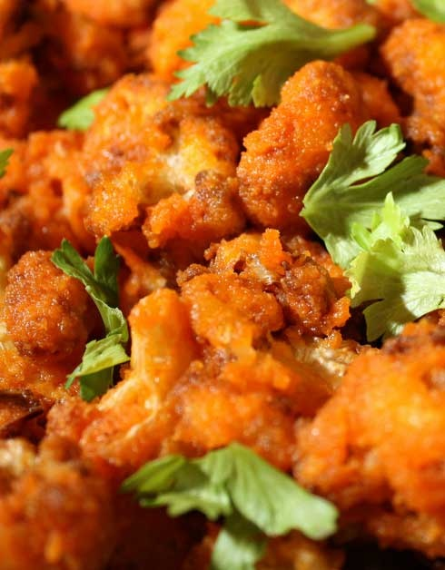 Recipe for Buffalo Baked Cauliflower - You may have noticed that we have been sharing a lot of cauliflower recipes, the other white meat/potato, lately. Some of these recipes have been very good but in no way related to what they are supposed to mock. These Buffalo Fried Cauliflower bits are actually a pretty good knock off of boneless chicken wings. And here is a recipe that gives you a batch of hot, and a batch of mild 'wings'.