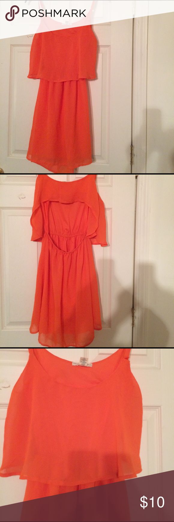 Flowy summer orange dress Juniors orange flowy summer dress. It's a small and is in great condition barely worn. Cute summer time dress for casual or going out occasions. Dresses Midi