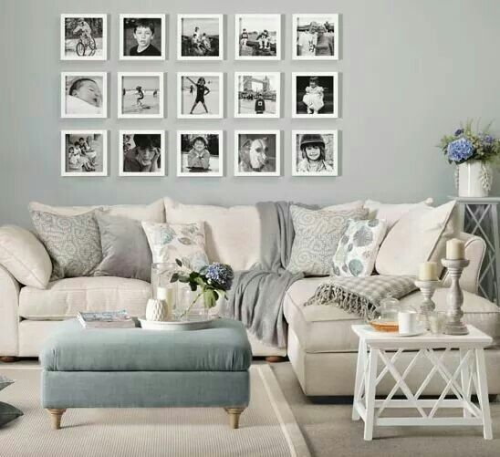 Nuetral family room. Sofa with photo wall gallery