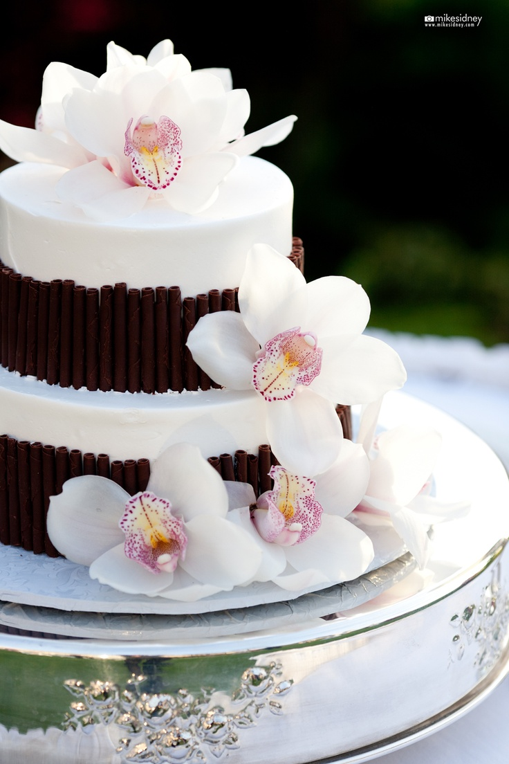 2 tier maui wedding cake with orchids wwwmikesidneycom
