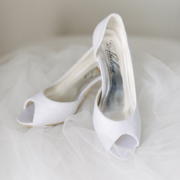 Lace Peeptoe Wedding Shoes by Pearl & Ivory ®  - Find more elegant wedding shoes from our collection www.pearlandivory.com/bridal-shoes.html. Photography by Yolande Marx #PearlandIvory #WeddingShoes #Lace #Peeptoe #BridalShoes