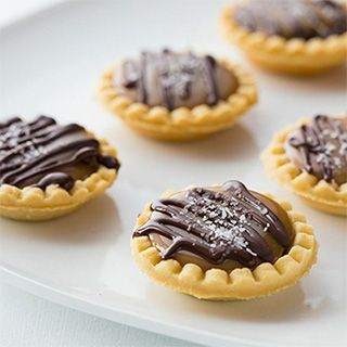 A mouthwatering mix of salty and sweet, these Mini Salted Caramel Chocolate Pies are just the ticket. Pre-baked mini pie shells cut out half the work.
