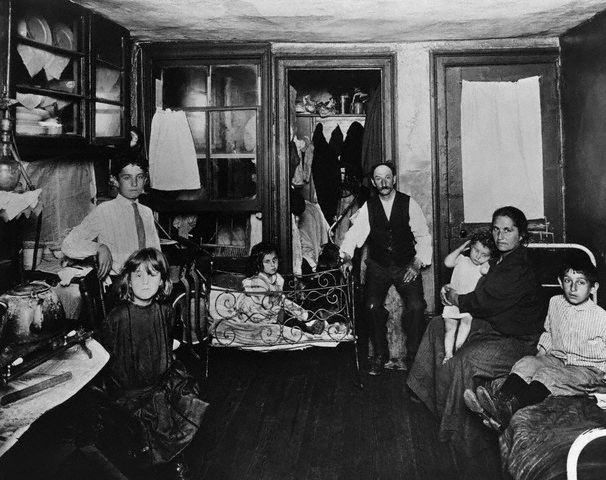 ca. 1880s, New York City — Poor family in one room tenement apartment — Photo by Jacob Riis, Image © Bettmann/Corbis