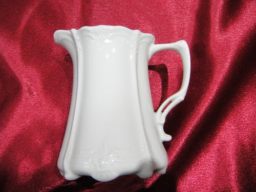 """My china pattern: """"Baroness White"""" by Huschenreuther. This is the creamer. The cups also have this open work on the handle."""