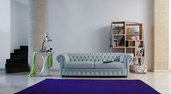 Similar to the two existing light blue Chesterfield sofas.