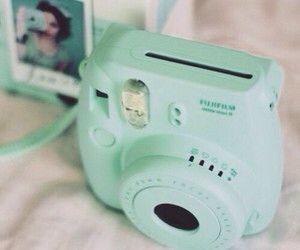 Minty Polaroid camera