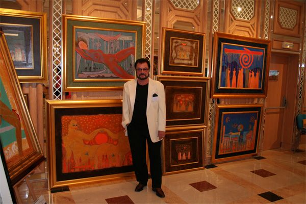 Juhani Palmu and his paintings.