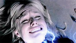 """Drak shoved Tarni to her knees while Logan held Elic at gunpoint. Drak looked up at Elic with pure hatred in his eyes, then hissed, """"Shall I provide you with some motivation besides saving your own miserable skin?"""" His hand started to glow, then suddenly a jolt of electricity flashed through his fingers into Tarni's neck."""