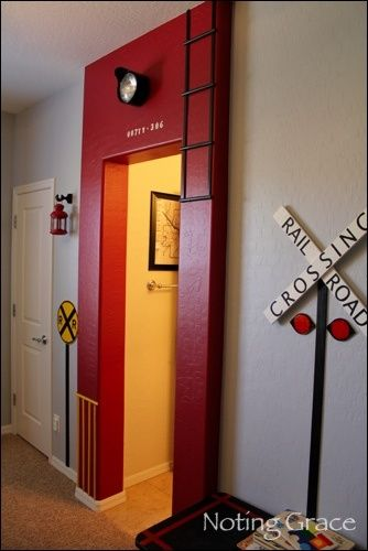 Entry to kid's room that has a train theme.
