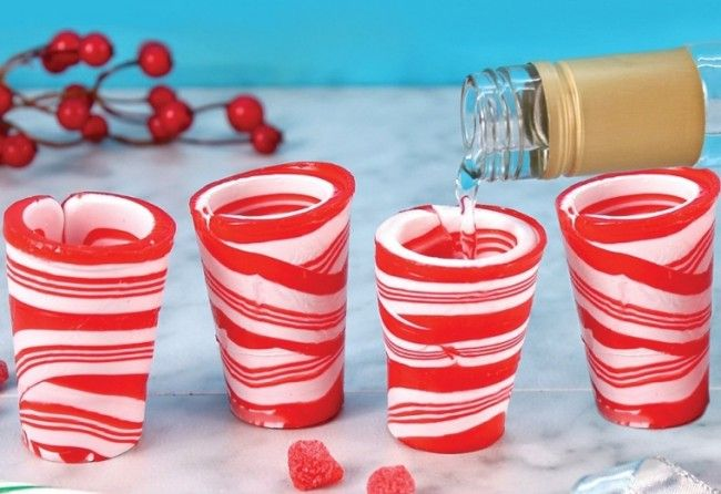 Candy Cane Christmas Shot Glasses - Shot glasses made of candy canes! They actually hold liquid and you can eat them when you're done!   Link    #Christmas #Christmas2015