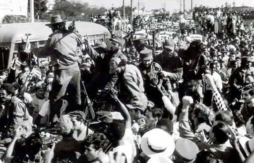 January 1959: Fidel Castro (centre) and his guerrillas entering Havana after taking control of the city.