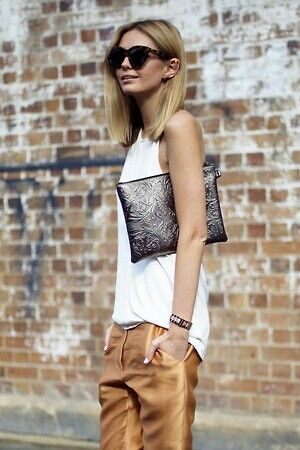 simple, chic, defining. Love her haircut, sunglasses & style