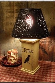 Primitive Mustard Crow Lamp...with punched tin shade.  Love the homespun checked runner.