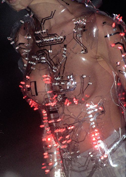 Sarah Burton: ''I remember one collection - the prêt-à-porter autumn/winter 1999-2000 collection - which involved a model in a Perspex robotic body '' Flashing LED's and Perspex bodice by Kees van der Graaf for Alexander McQueen at Givenchy , Paris .