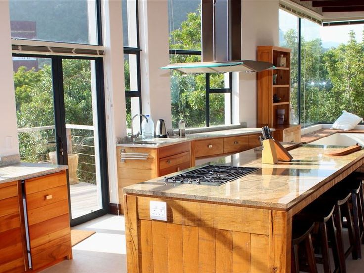 Wavesong Nature's Valley - Directly on the beachfront, Wavesong Nature's Valley is a modern, spacious two storey home with 360-degree ocean and mountain views, six luxurious bedroom suites, a large children's den and a lift for ... #weekendgetaways #naturesvalley #southafrica