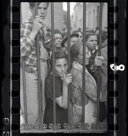 VALENCIA, Spain—A crowd at the gate of a morgue after an air raid, May 1937. © Gerda Taro © 2002 by International Center of Photography/Magnum Photos / Magnum Photos