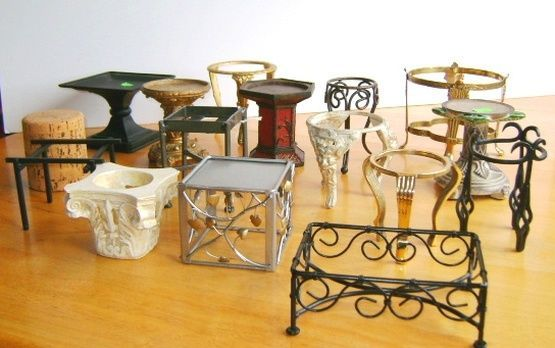 candle holders make great dollhouse tables...dining table, end tables, coffee table; garden features such as plant stands, a fountain, a bench; mini boutique display stands...kj