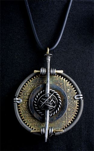 Pendant | Richard Salley.  Etched brass clock gear, nail, brass, steel washer, iron wire, rubber cord
