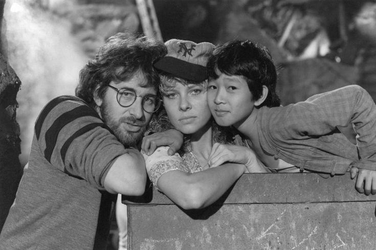 Steven Spielberg, Kate Capshaw, and Jonathan Ke Quan on the set of Indiana Jones and the Temple of Doom