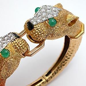 VINTAGE KUTCHINSKY DOUBLE PANTHER BRACELET, SOLID 18K GOLD WITH DIAMONDS &  EMERALD EYES