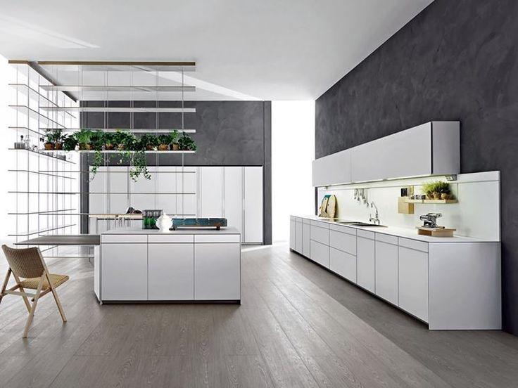 Essenziale, lineare, compatta, dotata di tecnologia di ultima generazione, la cucina di design moderna è spesso dotata di isola centrale per ampliare lo spazio di lavoro e per mangiare in compagnia in modo informale e pratico. http://www.arredamento.it/cucina-design.asp #cucina #cicinadesign #funzionale #essenziale