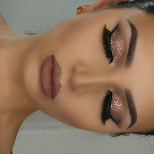 Closed eye makeup of prev post. Brows:@anastasiabeverlyhills Dipbrow in Ebony set with Clear Brow Gel. Eyes: @urbandecaycosmetics Naked Smoky Palette. Glitter is from Violet Voss in Olivia Kat Von D Beauty Ink Liner in Trooper @shophudabeauty Mink lashes in Sophia lips: Mac lip pencil in stone NYX Cosmetics Liquid Suede Cream Lipstick in Sandstorm. by beautybyfaz