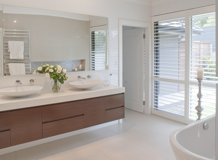 Reverse for vanity, thick timber look bench top with gloss white cupboards/drawers underneath.