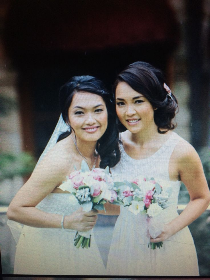 A beautiful Bride and a pretty Bridesmaid.