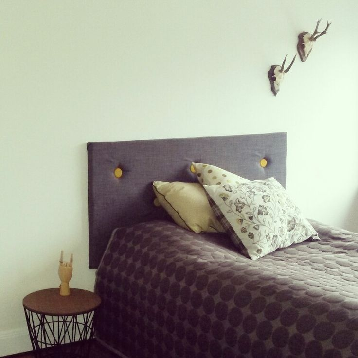 DIY hedboard for the bed. Love it!